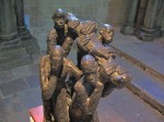 B: African statuette of the burial of Christ in bronze.