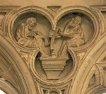 F: Figures of monks, sitting at desks as if at work in the scriptorium of the Priory. Above the tomb of Archbishop Simon Meopham in the South Quire aisle.