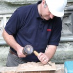 Houghtons Chiseller working on the Christ Church Gate