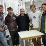 Sam Matthews with his fellow stonemason apprentices and tutor Steve Manuel
