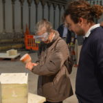 A visitor tries some masonry for the first time