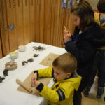Young visitors take part in a clay gargoyle activity.