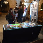 Students look at some Victorian stained glass in the Crypt.