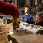 A pair of budding young archaeologists learn about some Canterbury skulls.